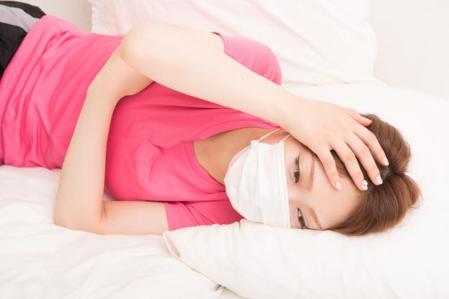 熱で倒れる女性